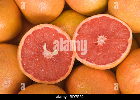 Texas 'Red' Grapefruits halved. - Stock Photo