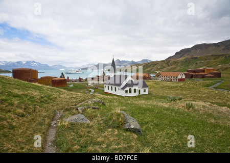 Old Norwegian white church abandoned whaling station Grytviken harbour King Edward Cove South Georgia Antarctica - Stock Photo