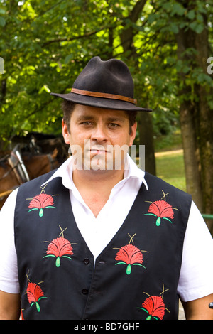 Horse and Carriage Driver in Traditional Costume, Bled Slovenia - Stock Photo