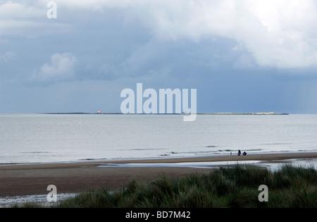 View from Bamburgh Beach looking across Inner Farne. Northumberland, England, UK - Stock Photo