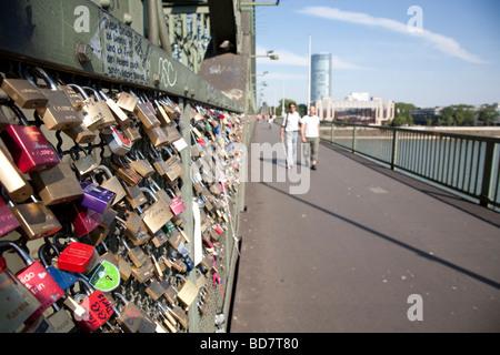 padlocks on fence of footpath of Hohenzollern railway bridge Cologne Germany - Stock Photo
