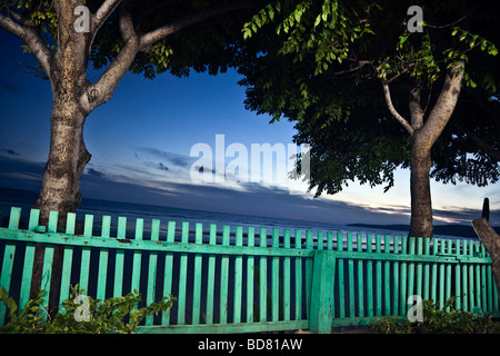 Indonesia Sulawesi Pantai Bira Bira Beach twilight view toward ocean of a surreal scene turquoise colored fence - Stock Photo