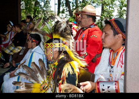North American Plaims Native Indian in traditional dress at Pow Wow in the Indian Village at the Calgary Stampede - Stock Photo