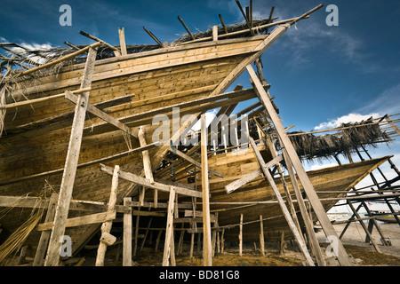 Indonesia Sulawesi Tanah Beru near Pantai Bira Bira Beach traditional wooden ship building area at late afternoon - Stock Photo