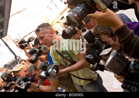 Paparazzi photographers at work photographing celebrities outside Mayfair hotel London United Kingdom - Stock Photo