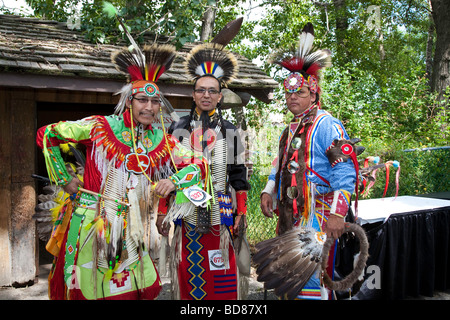 North American Plains Native Indian in traditional dress at Pow Wow in the Indian Village at the Calgary Stampede - Stock Photo