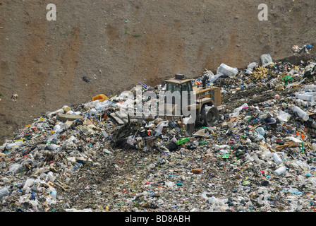 A tractor compactor working in a landfill site in France. (Lorraine region) - Stock Photo