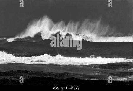 Large storm waves off Kauai coast Hawaii - Stock Photo