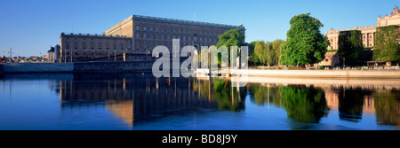 Fishing for salmon in front of the Royal Palace and the Old Town at sunrise in Stockholm - Stock Photo