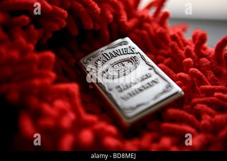 Jack Daniels Tenessee whiskey zippo lighter - Stock Photo