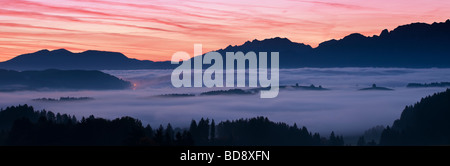 Ground fog coveres landscape Allgaeu region Bavaria Germany - Stock Photo