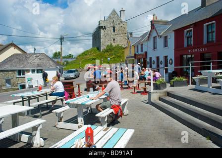 Tourists enjoy summer weather in Baltimore, West Cork, Ireland - Stock Photo