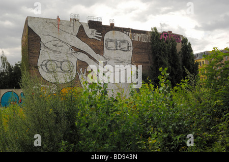 Mural by artist - Blu - on a firewall in Cuvrystrasse in Berlin-Kreuzberg - Stock Photo