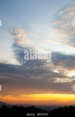 Sunset sky over horizon with stratocumulus clouds - Stock Photo