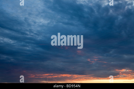 Dusk twilight sky with stratocumulus clouds - Stock Photo