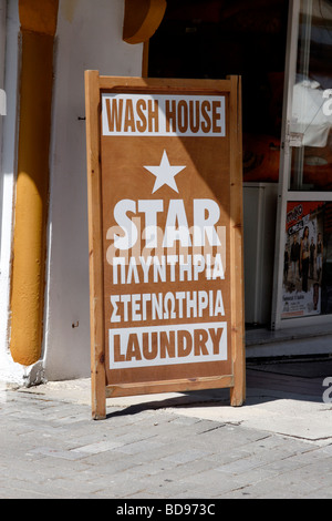 Wash house and laundry service sign Rhodes New Town Rodes Greece - Stock Photo