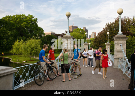BICYCLISTS on a bridge in the BOSTON COMMON which is a public park and garden completed in the year 1837 BOSTON MASSACHUSETTS