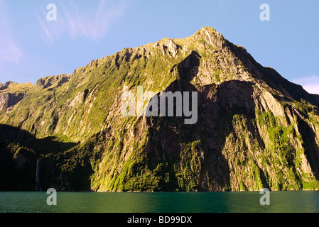 A shadow resembling a 'black rider' LOTR on the mountain at Milford Sound