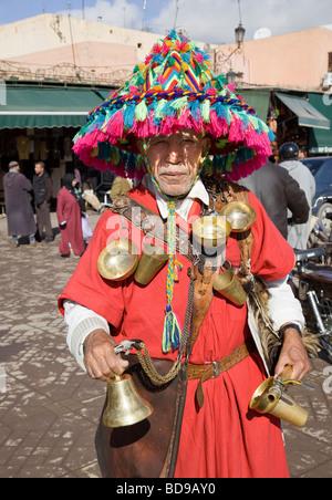 'Gerrab' (Water-seller), Place Jemaa el-Fna, Marrakesh, Morocco - Stock Photo
