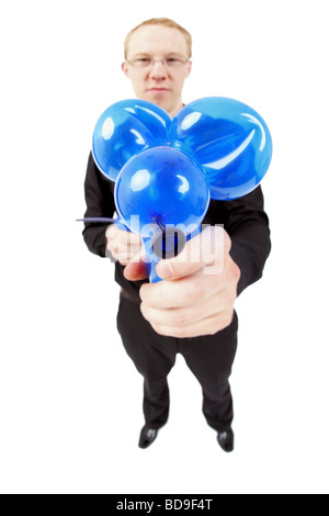young magic tinkering a balloon animal with balloons - Stock Photo