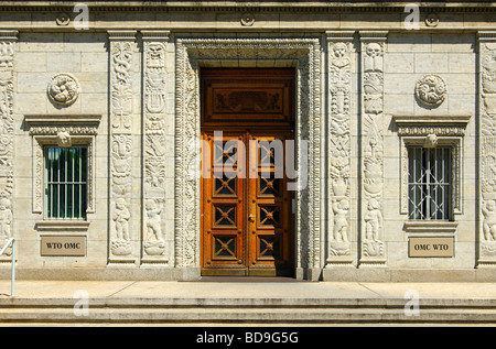 Door with bas relief decoration at the main entrance to the World Trade Organization, WTO, Geneva, Switzerland - Stock Photo