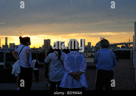 Local people watching sunset over Tokyo from Odaiba artificial island Tokyo Japan - Stock Photo