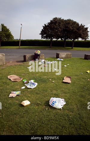 Rubbish along Otterspool Promenade has been blown around an overfull bin that has not been emptied for some time - Stock Photo