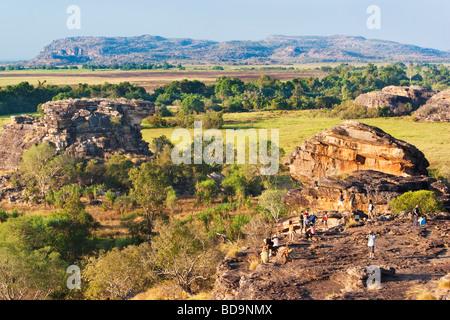 Tourists gather on Ubirr Rock to watch the sunset. Kakadu National Park - Stock Photo