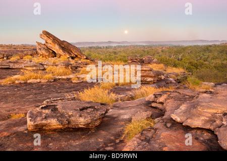 The moon rising above Ubirr Rock in Kakadu National Park UNESCO World Heritage site. Australia - Stock Photo