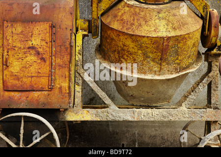 a cropped, close up of an old cement mixer - Stock Photo