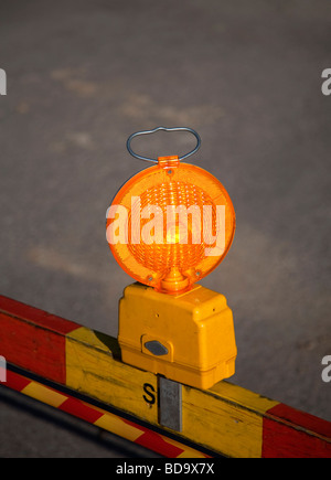 Warning strobe light at roadworks site - Stock Photo