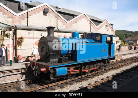 Blue steam locomotive engine in the Lakeside railway station on the Lakeside Haverthwaite railway line Cumbria England - Stock Photo