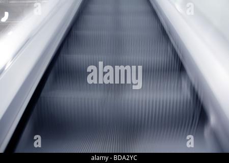 fast moving empty escalators steps - Stock Photo