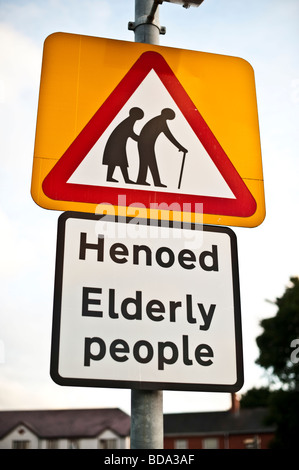 Elderly People - Henoed in welsh - road sign warning triangle bilingual welsh english language - Stock Photo