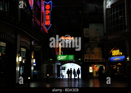 People in silhouette entering the Printworks in Manchester - Stock Photo