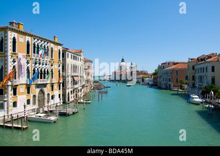 Venice, Veneto, Italy. Church of Santa Maria della Salute and Grand Canal seen from the Ponte dell Accademia. - Stock Photo