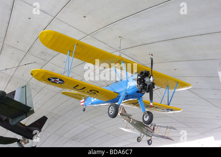 Stearman Kaydet in the foreground and the Spad XIII in the background,both suspended from the roof space at the - Stock Photo