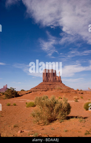 Desert sand and Rock formations at Monument Valley in the Navajo Tribal Park, northeastern Arizona, USA - Stock Photo