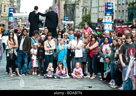 Crowds watch street performers in the Royal Mile during the Edinburgh Fringe Festival August 2009 - Stock Photo