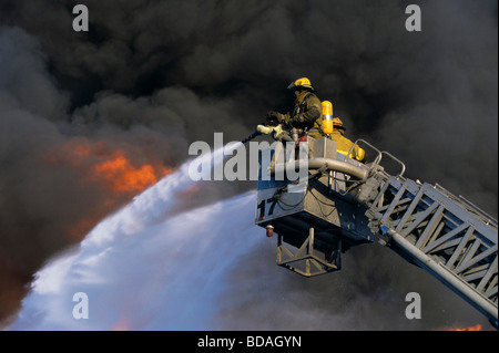 Detroit Firefighters battle 2nd Alarm fire from Tower Ladder - Stock Photo