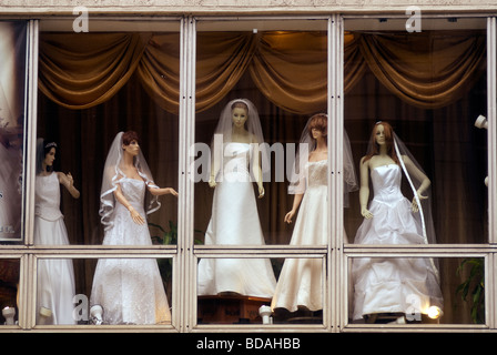Mannequins displaying wedding dresses in the window of a retailer in New York on Sunday August 9 2009 Richard B - Stock Photo