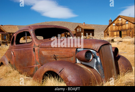 Abandoned, rusted out coupe in historic town of Bodie, California - Stock Photo