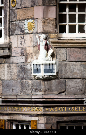 A carving of John Knox the Scottish 16th Century religious reformer, on the corner of his house in Edinburgh's Royal - Stock Photo