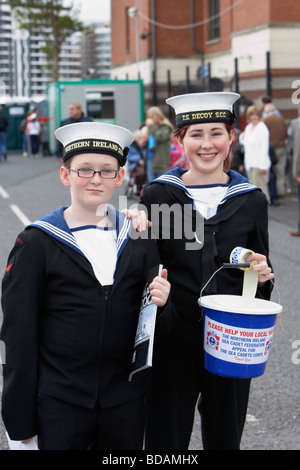 two sea cadets boy and girl raising money for charity at an outdoor event in belfast city northern ireland uk - Stock Photo