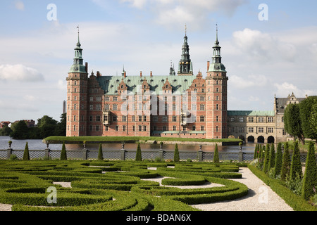 The Frederiksborg Castle in Dutch Renaissance style and the baroque garden in Hillerød near Copenhagen, Denmark. - Stock Photo