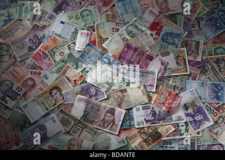 An arrangement of various international currencies. - Stock Photo
