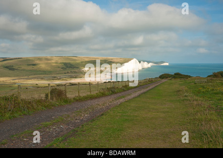 View of Seven Sisters chalk cliffs from Seaford Head with leading path - Stock Photo
