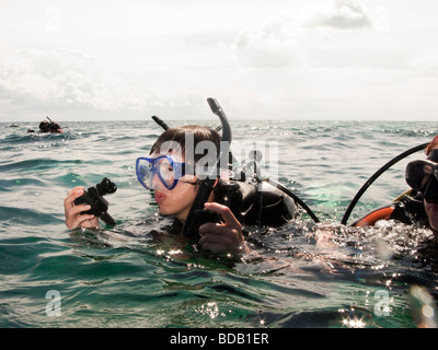 Indonesia Sulawesi Hoga Island Operation Wallacea diver on surface of water after dive - Stock Photo