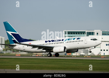 A Westjet Boeing 737 jet taking off from Calgary International Airport (YYC), Alberta,Canada. - Stock Photo