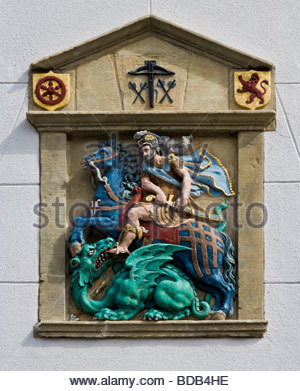 Saint George killing dragon religion legend symbol stonemasonry coat of arms house wall leadership Heusden Netherlands - Stock Photo